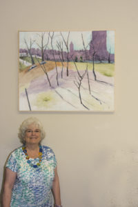 1 Ricki standing by her painting at the Vyt